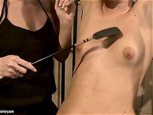 Kathia Nobili spanking a sweetheart babe on the face