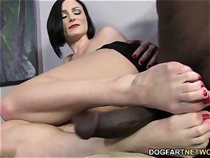 Veruca James satisfies a phat black jizz-shotgun with her soles