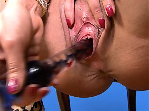 luxurious Lisa Ann tucks her faux-cock deep in her humid vagina
