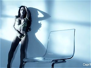 buxom black-haired Capri Cavanni works her wet labia
