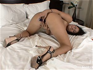 Pierced chinese London Keyes plays with her slit in bed